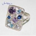 Серебряное кольцо с цветными цирконами.